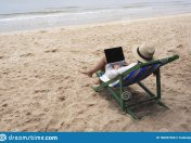 woman-using-typing-laptop-computer-beach-chair-woman-using-typing-laptop-computer-lying-down-160297930